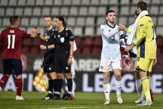 Scotland's Andrew Robertson and goalkeeper David Marshall (right) shake hands after the UEFA Nations League Group 2, League B match at Andruv Stadium, Olomouc.