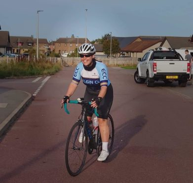 Buckie woman Stephanie Cormack  cycles 100 miles to raise more than £1,700 for charity that supports her husband who suffers from MS.