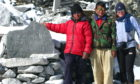 Sue Agnew, right, with the memorial cairn for her uncle, George Fraser, near his former base camp