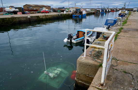 Lobster type fishing boat sank overnight within Burghead Harbour.