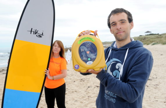 Sandra McKandie (from Keiran's Legacy) and Kev Anderson from Surfable Scotland at Hopeman Beach. Picture by Darrell Benns.