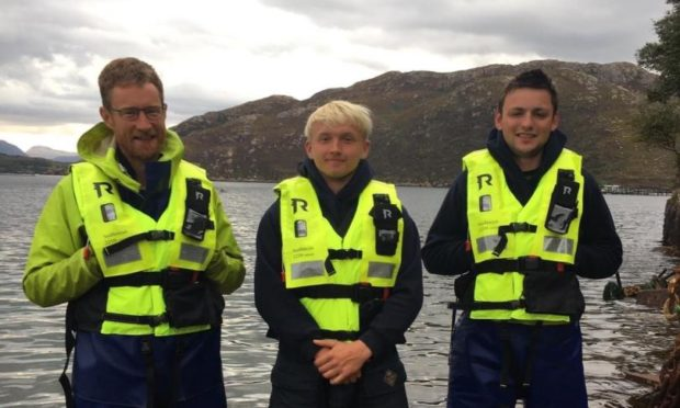 Marine operatives Tom Charles Edwards, Gregor Oliver and Joseph Finlayson helped rescue three kayakers in Loch Torridon in recent weeks.