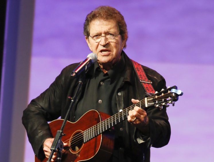 Mac Davis performs at the Texas Film Awards in Austin, Texas on March 6, 2014. Photo by Jack Plunkett/Invision/AP