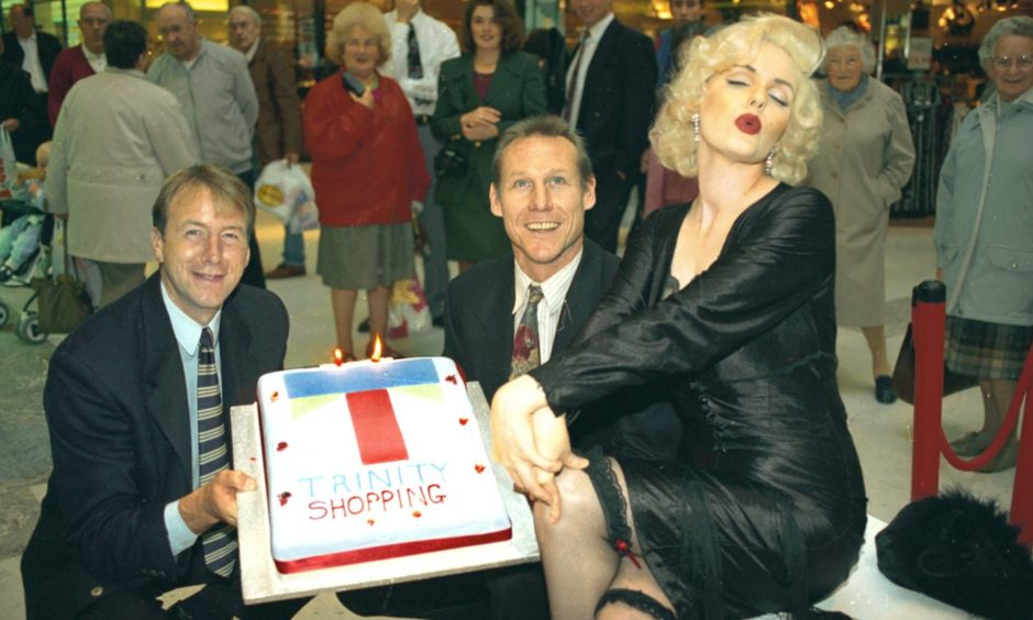 Aberdeen's Trinity Centre shopping arcade enjoyed a VIP birthday treat in 1994. Marilyn Monroe lookalike, Pauline Baily, of Red Dwarf fame, turned heads as she helped mark the centre's 10th birthday celebrations. Joining Marilyn were former local soccer heroes Neil Simpson, left, and Doug Rougvie.