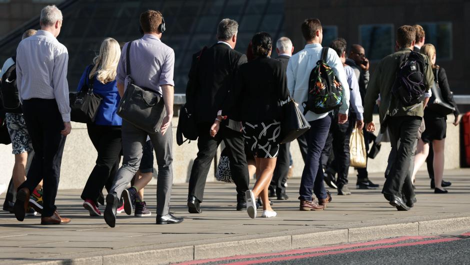 City workers walking along London Bridge.