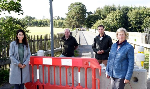 The Park Bride Action Group is calling for the crossing to be reinstated. In the picture are from left: Lynn Coull, Kevin McPhee-Smith, Andrew Bowie MP and Anne Shearer.  Picture by Jim Irvine  11-9-20