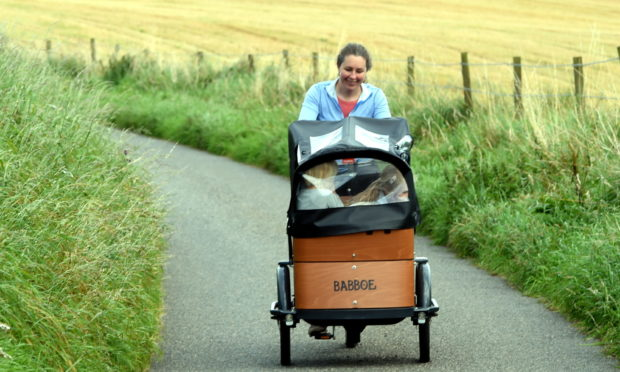 Aberdeenshire mum Angie Fraser on her eye-catching cargo bike.