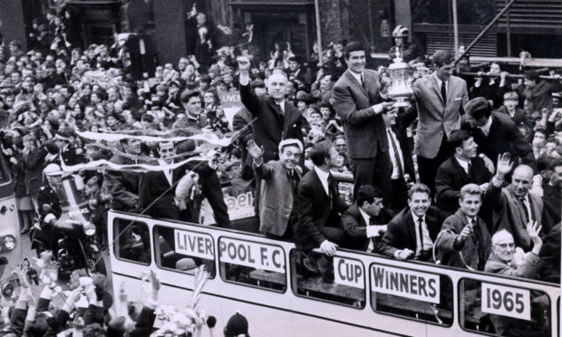 Ron Yeats with the FA Cup and Bill Shankly on the victory parade following victory in 1965.