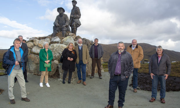 The mountaineer memorial with members of the Collie Mackenzie Heritage Group