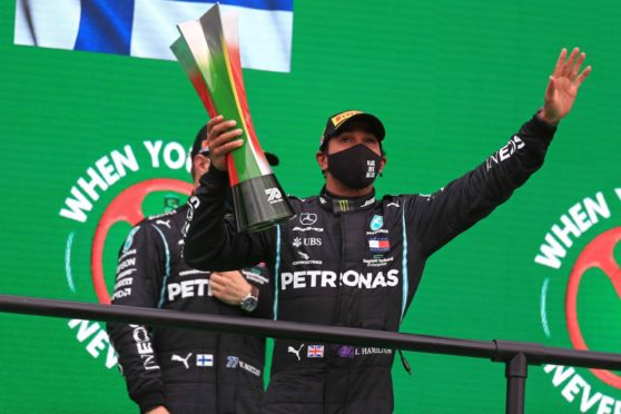 Mandatory Credit: Photo by Leanne Boon/Octane/Action Plus/Shutterstock (10972569aa) Mercedes AMG Petronas F1 W11 EQ Performance, Lewis Hamilton takes his 92nd win as he celebrates on the podium; Algarve International Circuit, Portimao, Portugal; Formula One, Portugal Grand Prix, Race Day. 2020 F1 Portuguese Grand Prix, Algarve International Circuit, Portimao, Portugal - 25 Oct 2020