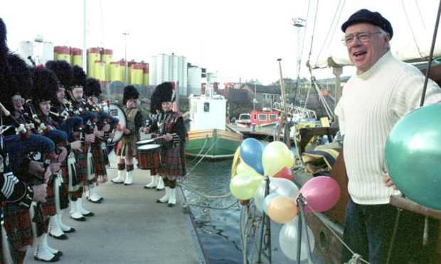 John Duncanson is surprised by pipers on his 60th birthday.