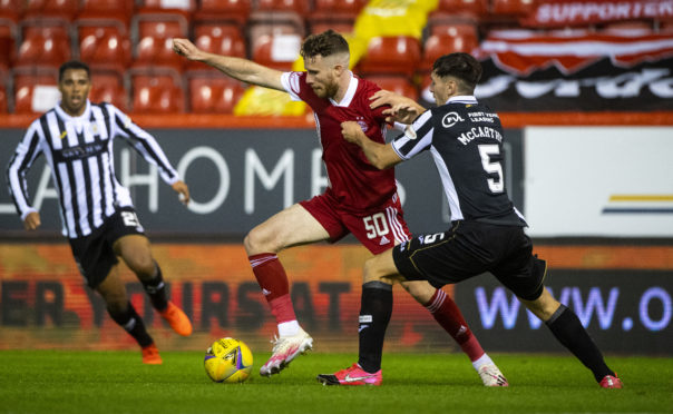 Aberdeen's Marley Watkins and Conor McCarthy in action