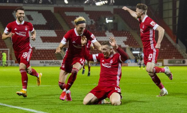 Lewis Ferguson celebrates after scoring to make it 2-1 to Aberdeen against St Mirren.