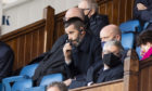 Ross County manager Stuart Kettlewell watches on from the stand against Rangers.