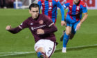 Hearts' Jamie Walker tucks home from the spot.