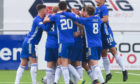 Cove Rangers players celebrate against Hibernian.