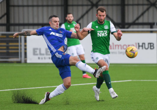 Cove Rangers defender Scott Ross in action against Hibernian.