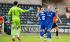Peterhead's Scott Brown celebrates with Josh Rae against Dundee.