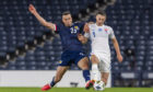 Scotland's Andy Considine (left) battles with Slovakia's Robert Bozenik.