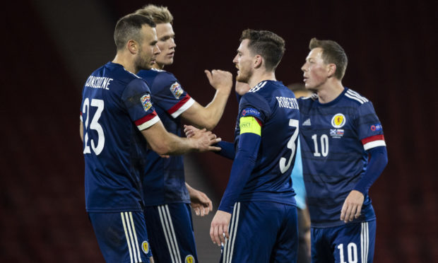 Scotland skipper Andy Robertson congratulates Aberdeen's Andy Considine, left, at full-time after his cap against Slovakia at Hampden.