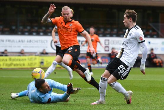 Aberdeen's Scott Wright (R) chips the ball over Benjamin Siegrist.