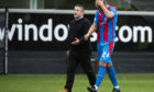 Inverness manager John Robertson speaks with Robbie Deas at full-time.