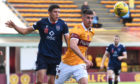 Ross County's Ross Stewart (L) in action with Declan Gallagher of Motherwell.
