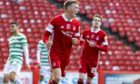 Aberdeen's Lewis Ferguson celebrates after scoring against Celtic. Brown will likely help the midfielder develop further.