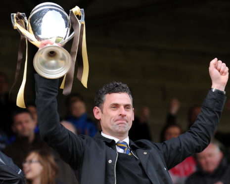 Charlie Rowley holds aloft the Highland League title in 2012.