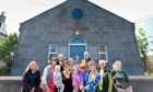 Susan McDonald, Mary Falconer, Gordon Wilson, Lizzie Whitely, anne Coles, Natalie Farrell, Marianne Wamser, Graeme Falconer, Sarah Budge and Pauline Brown outside Fittie Community Hall.