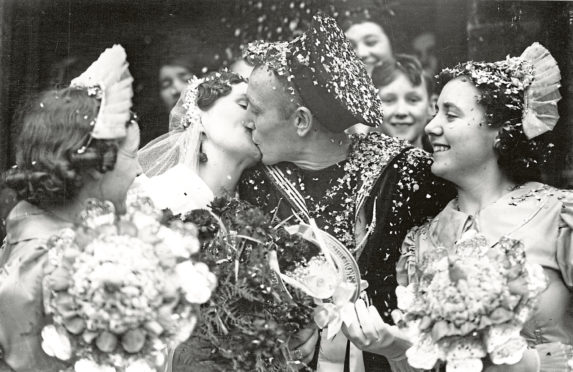 Picture shows: The bride and bridegroom kissing after their wedding today.