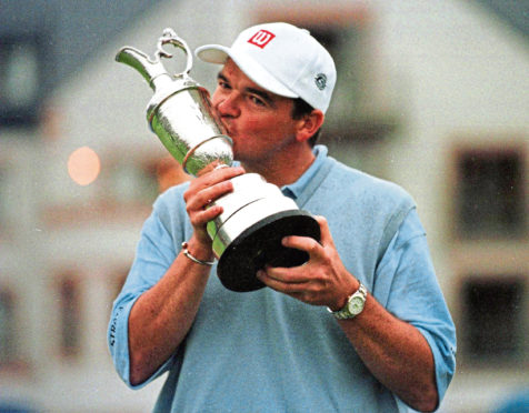 Paul Lawrie with the Claret Jug in 1999.