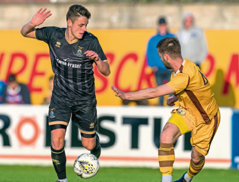 Cameron Harper, left, playing for Caley Thistle.