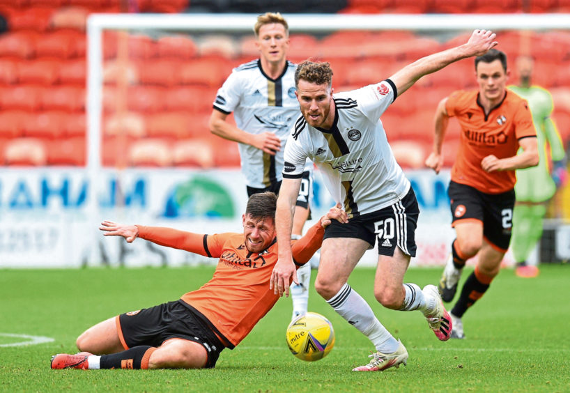 Marley Watkins (R) and Dundee United's Calum Butcher.
