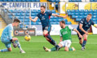 Ross County goalkeeper Ross Doohan denies Christian Doidge of Hibs.