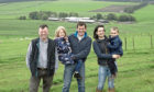 ScotSheep chairman Willy Millar, left, with host farmers Robert and Hazel McNee and children Kate and Alan.