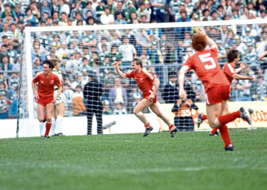 Aberdeen's Billy Stark (left), Stuart McKimmie, Alex McLeish (no 5) and Dougie Bell celebrate Mark McGhee's (not pictured) goal in extra time of the 1984 final.