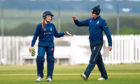Ailsa Lister, left, of Stoneywood-Dyce celebrating after taking a wicket. Picture by Scott Baxter