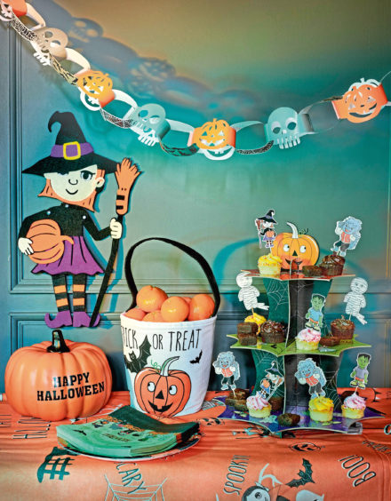 Pop-up cake stand, £3, packs of plates or napkins, £1 each, felt witch, £1, George Home at Asda