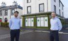 Tahir Rashid (l) and James Higgins (r) outside the new pharmacy in Tornagrain.