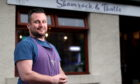 Pictured is Shamrock and Thistle owner Gerard Browne outside his cafe in Stonehaven. Picture by Scott Baxter.