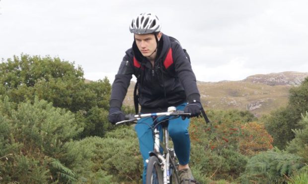 Eòsaph Caimbeul, 17, taking part in a charity cycle ride from Edinburgh to Skye.