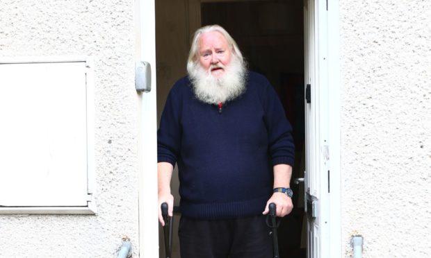 Angus MacPhee outside his house in Oban.