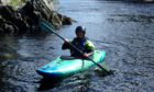 Enjoying a kayaking session on the River Spey.