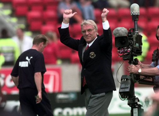 Aberdeen Manager Ebbe Skovdahl cheers on the fans before his first game in charge against Celtic in August 1999.