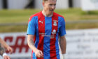 Shane Sutherland playing for Caley Thistle against old club Elgin City.