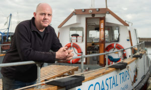 Furious recreation boat owner Barry Paskins with his boat.