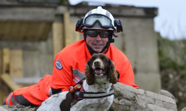 Diesel the dog, pictured with handler Gary Carroll, has picked up a 2020 Hero Pet award.
