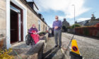 Elgin couple Pearl and Alan Riddell feel 'trapped' inside their own home on Academy Street as motorists park outside blocking their entrance. Picture by Jason Hedges.