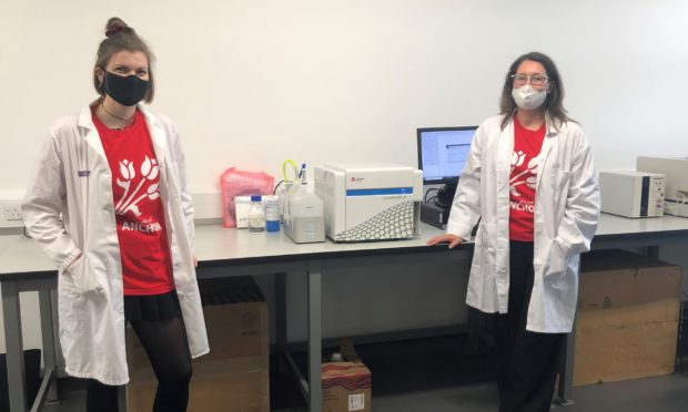 Joanna Robertson and Dr. Marie Goua with the Flow Cytometer